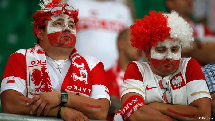 Fans of Poland react after their Group A Euro 2012 soccer match against Czech Republic at the City stadium in Wroclaw June 16, 2012. REUTERS/Sergio Perez (POLAND - Tags: SPORT SOCCER)