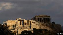 In this photo taken Sunday, Sept. 5, 2010, the elegant marble temple of Athena Nike, distinguished by its four Ionic columns, is lit by the sun as the Propylaea gate is seen on the left and the Parthenon temple in the shade on the right, on the Athens Acropolis. A ten-year restoration project has just been completed on the 2,400-year-old temple, which was dismantled to ground level and rebuilt to correct damage from ground subsidence and rusting internal joints. (ddp images/AP Photo/Petros Giannakouris)