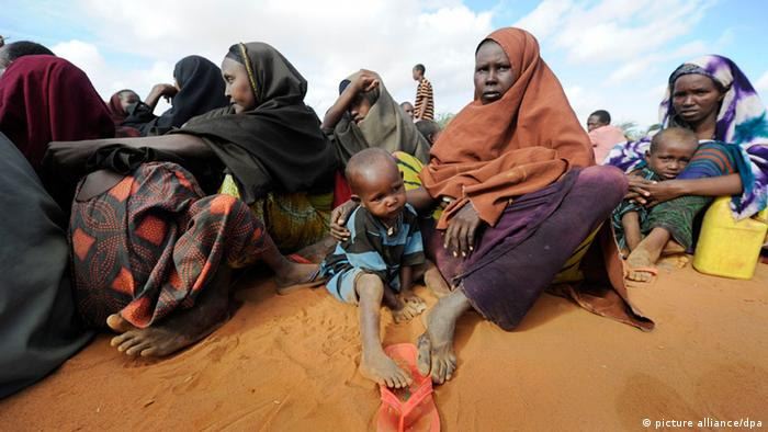 After weeks on the move Somali mothers have finally arrived at a refugee camp in Dadaab, northeastern Kenya Friday, August 5, 2011 and are now waiting to be granted access to a first medical examination and registration. Somalia and parts of Kenya have been struck by one of the worst droughts and famines in six decades, more than 350.000 refugees have found shelter in the world's biggest refugee camp. Foto: Boris Roessler dpa