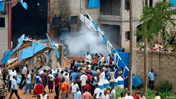 People gather outside a church following a blast in Kaduna, Nigeria, Sunday, June 17, 2012. Three church blasts rocked a northern Nigerian state Sunday, officials said, prompting protests in a state that has previously been strained by religious tensions. (AP Photo/Olu Ajayi)