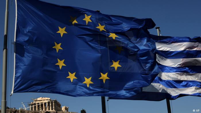 An EU and a Greek flag fly in front of ancient Parthenon temple, in Athens (Photo: AP Photo/Petros Giannakouris)