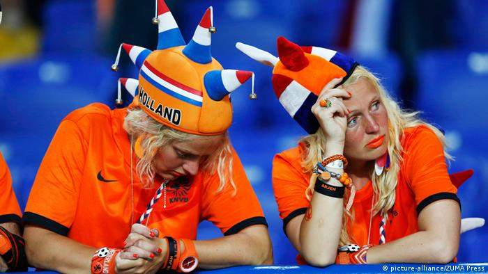 Netherlands fans look on dejected at the final whistle..Euro 2012 Netherlands v Germany, Kharkiv, Metalist Stadium, on the 13th June 2012. Pic David Klein/SPORTIMAGE
