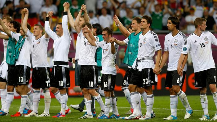 Germany's players celebrate winning their Group B Euro 2012 soccer match against Denmark at the New Lviv stadium in Lviv June 17, 2012. REUTERS/Eddie Keogh (UKRAINE - Tags: SPORT SOCCER)