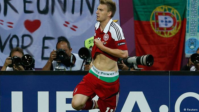Denmark's striker Nicklas Bendtner runs on the pitch displaying the name of Irish bookmaking firm Paddy Power on the waistband of his underpants during their Group B Euro 2012 soccer match against Portugal at the New Lviv stadium in Lviv June 13, 2012. Bendtner could face sanction by UEFA after revealing the logo of a betting company while celebrating his second goal against Portugal in their Euro 2012 clash on Wednesday. Bookmaker Paddy Power has told Reuters that Bendtner wasn't part of an organised ambush marketing attempt when he revealed their logo after scoring against Portugal. Picture taken June 13, 2012. REUTERS/Eddie Keogh (UKRAINE - Tags: SPORT SOCCER)