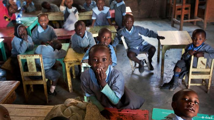 Children at the Ngong Primary School school look out through their classroom windows in Ngong, near Nairobi, Kenya (Photo: Ben Curtis)