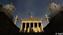 In this photo taken Friday, Oct. 21, 2011, marble statues of ancient Greek philosophers Socrates, right, and Plato, left, are seen on plinths in front of the Athens Academy, as the Greek flag flies. More than 200 international philosophers braved strikes and protests to come to Greece this month to join a forum and debate matters of the mind. Greece's illustrious ancient thinkers built the foundations of Western scholarship, and their philosophy stands as an unquantifiable source of national wealth even during a financial crisis. (Foto:Petros Giannakouris/AP/dapd)