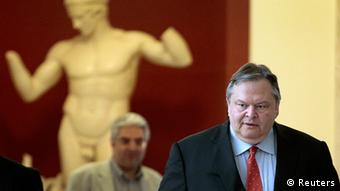 Evangelos Venizelos, the head of the Socialist PASOK party, arrives in parliament for a meeting with Conservative New Democracy leader Antonis Samaras in Athens June 18, 2012