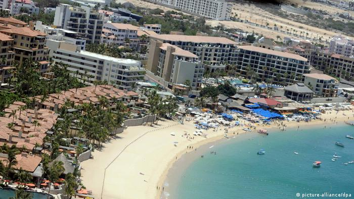 A handout picture provided by the Mexican Public Security Secretary shows a Federal Police helicopter patrolling the hotel area in Los Cabos