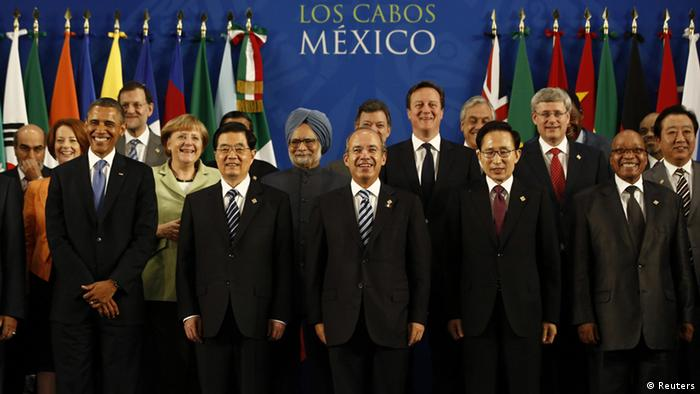 Leaders of the G20 nations gather for a group photo at the G20 summit in Los Cabos, Mexico, June 18, 2012. Pictured are (front row, L-R) U.S. President Barack Obama, China's President Hu Jintao, Mexico's President Felipe Calderon, South Korea's President Lee Myung-bak, South Africa's President Jacob Zuma, (second row, L-R) Australia's Prime Minister Julia Gillard, Germany's Chancellor Angela Merkel, India's Prime Minister Manmohan Singh, British Prime Minister David Cameron, Canada's Prime Minister Stephen Harper and Japan's Prime Minister Yoshihiko Noda. REUTERS/Jason Reed (MEXICO - Tags: POLITICS)