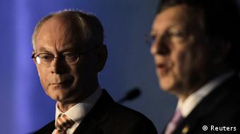 European Council President Herman Van Rompuy (L) listens as European Commission President Jose Manuel Barroso addresses the media before the G20 Summit in Los Cabos June 18, 2012.