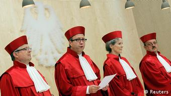President of the German Constitutional Court Andreas Vosskuhle (3rd R) and other judges arrive for the proclamation of a verdict on the German Government's European Stability Mechanism and the Euro Plus Pact in Karlsruhe June 19, 2012. REUTERS/Alex Domanski (GERMANY - Tags: POLITICS BUSINESS CRIME LAW)
