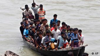 Rohingya Muslims, fleeing from ethnic violence in Myanmar between Buddhists and minority Rohingya Muslims, are brought by Bangladeshi border guards to a boat jetty