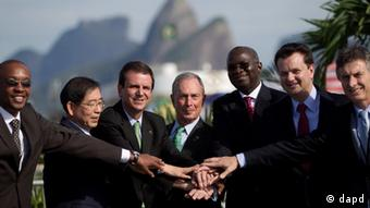 Mayors from left to right, Franklyn Tau of Johannesburg, Won Soon Park of Seoul, Eduardo Paes of Rio de Janeiro, Michael Bloomberg of New York, Babatunde Fashola of Lagos, Eduardo Kassab of Sao Paulo and Eduardo Macri of Buenos Aires pose for a photo during the Rio+C40 (Photo: Felipe Dana/AP/dapd)