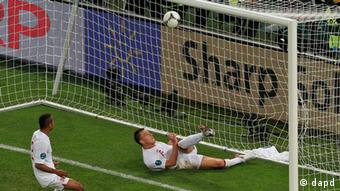 England's John Terry clears a ball that went over the line during the Euro 2012 soccer championship Group D match between England and Ukraine in Donetsk, Ukraine, Tuesday, June 19, 2012. (Foto:Vadim Ghirda/AP/dapd)