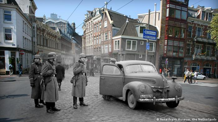 A photograph of Amsterdam during World War II superimposed on a contepporary photograph