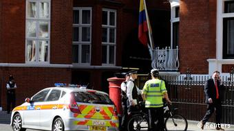 A man walks past Ecuador's embassy in London June 20, 2012. WikiLeaks' founder Julian Assange has taken refuge in Ecuador's embassy in London and asked for asylum, officials said on Tuesday, in a last-ditch bid to avoid extradition to Sweden over sex crime accusations. REUTERS/Paul Hackett (BRITAIN - Tags: POLITICS CRIME LAW)