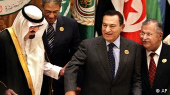 Saudi King Abdullah bin Abd al-Aziz, left, directs Egyptian President Hosni Mubarak (AP Photo/Amr Nabil)