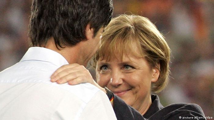 German Chancellor Angela Merkel (R) talks to German coach Joachim Loew after the 3rd place match of the 2006 FIFA World Cup between Germany and Portugal in Stuttgart, Germany, Saturday 08 July 2006. Germany won 3-1. DPA/ROLAND WITTEK +++ Mobile Services OUT +++ Please refer to FIFA's terms and conditions +++(c) dpa - Report+++