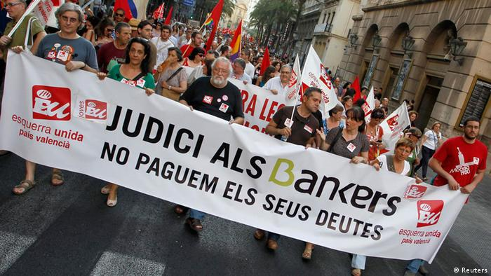 Protestors march during a demonstration against cuts in public services in central Valencia in June