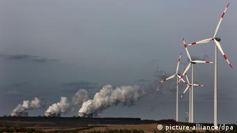 windmills in front of a coal-fired power station