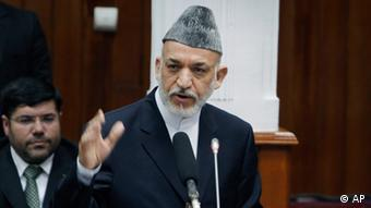 Afghan President Hamid Karzai speaks to lawmakers in parliament