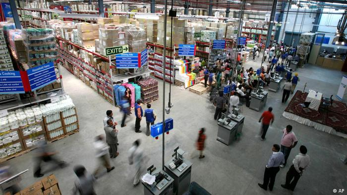 Workers walk during the inauguration ceremony of the first Wal-Mart / Bharti Enterprises joint venture store in Amritsar, India in 2009. (Photo:Altaf Qadri, File/AP/dapd)