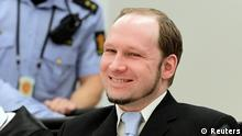 Norwegian far right mass killer Anders Behring Breivik smiles in court while the prosecutors deliver their closing arguments in Oslo June 21, 2012. Prosecutors will tell a Norwegian court whether they want Breivik to go to jail or to be committed to a mental institution because he was insane when he killed 77 people in 2011. REUTERS/Berit Roald/NTB Scanpix/Pool (NORWAY - Tags: CRIME LAW)