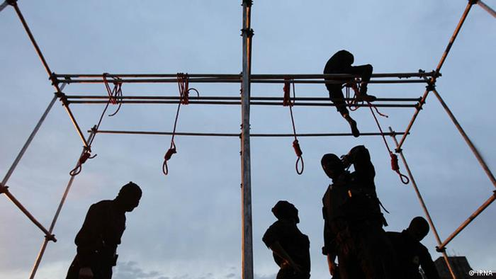 A man climbs the scaffolding of a wooden gallows in Iran (Photo: IRNA)
