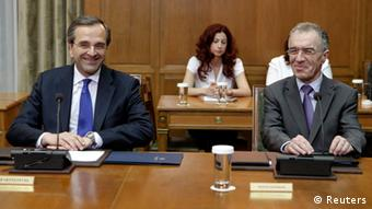Newly appointed Greek Prime Minister Antonis Samaras (C), leader of socialist PASOK party Evangelos Venizelos (R), Greece's National Bank chairman Vassilis Rapanos (L) and leader of Democratic Left party Fotis Kouvelis take part in a meeting in Athens June 21, 2012. The three parties forming Greece's new coalition government have agreed to ask lenders for two more years to meet fiscal targets under an international bailout that is keeping the country from bankruptcy, a party official said on Thursday. REUTERS/John Kolesidis (GREECE - Tags: POLITICS BUSINESS)