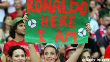 WARSAW, POLAND - JUNE 21: A Portugal fan enjoys the atmosphere ahead of the UEFA EURO 2012 quarter final match between Czech Republic and Portugal at The National Stadium on June 21, 2012 in Warsaw, Poland. (Photo by Alex Grimm/Getty Images)