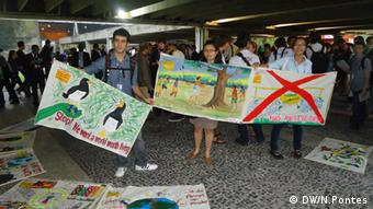 Young protesters bearing posters at the UN Climate summit in Rio.