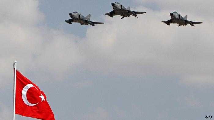 Turkish Air Force fighters fly over a national flag during a ceremony on the Victory Day in Ankara, Turkey, in this Aug. 30, 2007 file photo. Turkish warplanes hit Kurdish rebel targets in northern Iraq early Sunday, Dec. 16, 2007, Turkey's military said, the first such attack since the U.S.-led invasion of Iraq. (AP Photo/Burhan Ozbilici, File)
