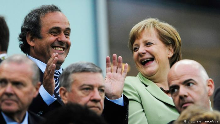 epa03277506 German Chancellor Angela Merkel (R) and UEFA President Michel Platini (L) pictured before kick off of the quarter final match of the UEFA EURO 2012 between Germany and Greece in Gdansk, Poland, 22 June 2012. EPA/GERRY PENNY UEFA Terms and Conditions apply http://www.epa.eu/downloads/UEFA-EURO2012-TCS.pdf +++(c) dpa - Bildfunk+++