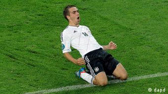 Germany's Philipp Lahm celebrates scoring the opening goal during the Euro 2012 soccer championship quarterfinal match between Germany and Greece in Gdansk, Poland, Friday, June 22, 2012.(Photo: AP)