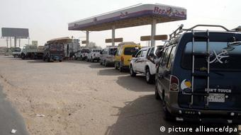 epa03275055 Sudanese queue to fill up their vehicles at a petrol station in Khartoum, Sudan, 21 June 2012. Media reports state that the Sudanese government on 20 June 2012 revealed a plan to implement an austerity package that will see subsidies on fuel being terminated, which would increase the price of one gallon of fuel by five Sudanese Pounds (1.5 euros). The Sudanese government is trying to control the budget deficit which increased after the drop of oil revenues following South Sudan_s secession last year. EPA/STR