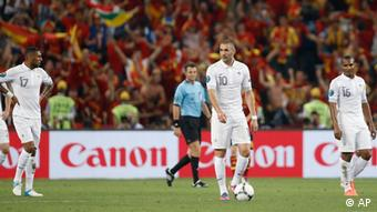 France's Karim Benzema, cener, and teammates react after a Spain goal during the Euro 2012 soccer championship quarterfinal match between Spain and France in Donetsk, Ukraine, Saturday, June 23, 2012. (AP Photo/Laurent Cipriani)