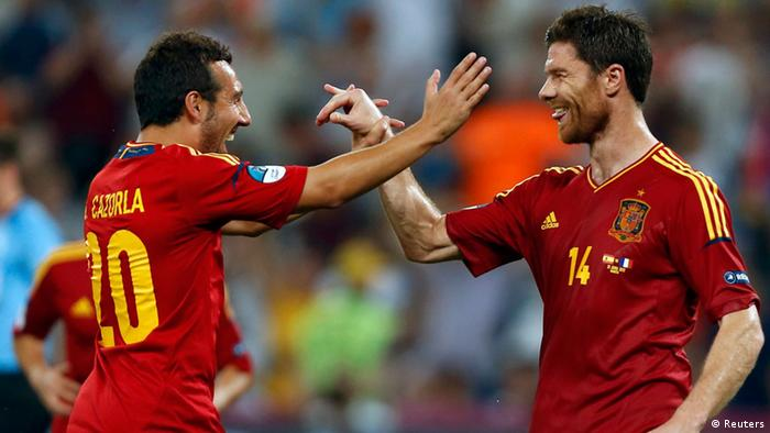 Spain's Xabi Alonso and Santi Cazorla (L) celebrate during their Euro 2012 quarter-final soccer match against France at the Donbass Arena in Donetsk, June 23, 2012. REUTERS/Charles Platiau (UKRAINE - Tags: SPORT SOCCER)