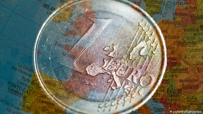 Euro coin in fornt of map of Europe