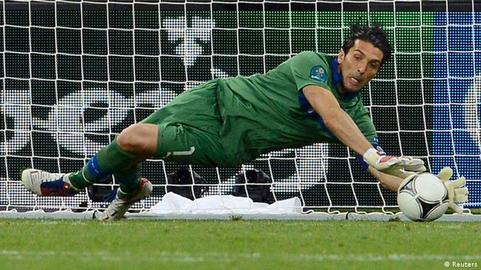 Italy's goalkeeper Gianluigi Buffon makes a save during the penalty shoot-out of their Euro 2012 quarter-final soccer match against England at Olympic Stadium in Kiev, June 24, 2012. REUTERS/Nigel Roddis (UKRAINE - Tags: SPORT SOCCER)