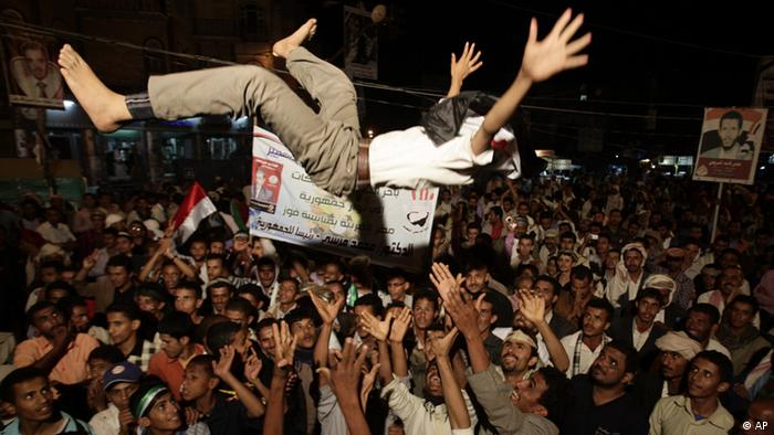 Yemeni protestors celebrate the victory of the newly elected President Mohammed Morsi during a rally at Taghyeer (Change) Square in Sanaa. Yemen, Sunday, June 24, 2012. Morsi has called for unity and said he carries