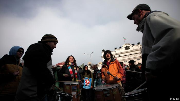 Environmental activists play drums in front of the Bulgarian Parliament during a demonstration in Sofia, Wednesday, Jan. 11, 2012. A coalition of non-government organizations and civil groups staged a protest to express dissatisfaction with amendments to the Forestry Act, which will allow investors to build skiing facilities without the need to change the zoning of the land. (AP Photo/Valentina Petrova).