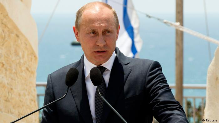 Russian President Vladimir Putin speaks during an unveiling ceremony for a monument commemorating the victory of the Soviet Red Army in World War Two in the coastal city of Netanya, north of Tel Aviv June 25, 2012. Israeli President Shimon Peres on Monday urged visiting Putin to take steps to avert the threat of a nuclear-armed Iran and to stop the bloodshed in Syria. REUTERS/Jack Guez/Pool (ISRAEL - Tags: POLITICS)