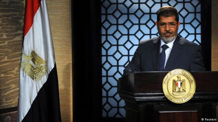 Mohamed Morsi speaks during his first televised address