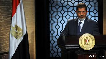 25/06/12 11:42:24 1929x2800(446kb) Muslim Brotherhood's president-elect Mohamed Morsy speaks during his first televised address to the nation in Cairo Muslim Brotherhood's president-elect Mohamed Morsy speaks during his first televised address to the nation at the Egyptian Television headquarters in Cairo June 24, 2012. Morsy's victory in Egypt's presidential election takes the Muslim Brotherhood's long power struggle with the military into a new round that will be fought inside the institutions of state themselves and may force new compromises on the Islamists. Picture taken June 24, 2012. To match Analysis EGYPT-ELECTION/STRUGGLE/ REUTERS/Stringer (EGYPT - Tags: POLITICS ELECTIONS)