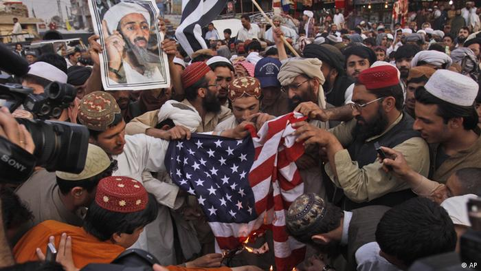 Supporters of the Pakistani religious party Jamiat Ulema-e-Islam (Nazriati group) burn representation of US flag at a pro-Osama bin Laden rally in Quetta, Pakistan on Wednesday, May 2, 2012 (Photo: Arshad Butt/AP/dapd)