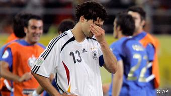 Germany's Michael Ballack reacts after the extra time of the semifinal World Cup soccer match between Germany and Italy in Dortmund, Germany, Tuesday, July 4, 2006.
