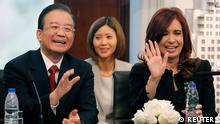China's Premier Wen Jiabao (L) and Argentina's President Cristina Fernandez de Kirchner (R) attend a signing agreement ceremony at Presidential Palace in Buenos Aires June 25, 2012. In a written speech released upon his arrival , Wen said frequent high-level exchange visits between China and Argentina have deepened political mutual trust and fruitful cooperation in such sectors as economy, trade, culture, education, science and technology since the establishment of diplomatic ties 40 years ago. REUTERS/Enrique Marcarian (ARGENTINA - Tags: POLITICS)