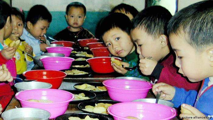 North Korean school children have lunch at a nursery in Pochon county in Ryanggang province