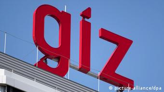 The GIZ logo on the roof of its headquarters Photo: Frank Rumpenhorst dpa/lhe