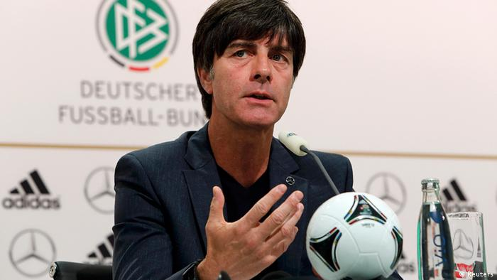 Germany's national soccer coach Joachim Loew gestures during a news conference before their Euro 2012 soccer match against Italy in Gdansk, June 26, 2012. REUTERS/Thomas Bohlen (POLAND - Tags: SPORT SOCCER)